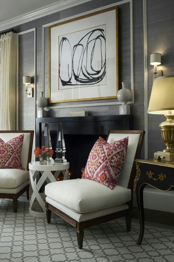 traditional with a modern twist or modern with a traditional twist? slipper chairs and modern art make a great vignette