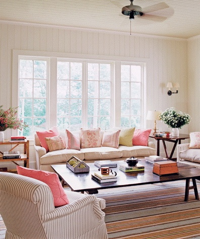 A happy lounge room. I like the ticking chair and side tables and vj walls
