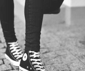 all black high top converse on feet