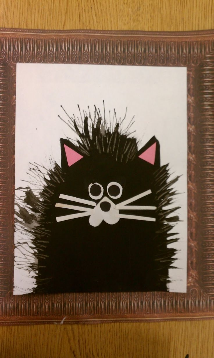 Art Rocks! blog Splat the Cat paintings..black paint..then take plastic fork and pull out paint to make hair..add construction paper whiskers& ears&eyes