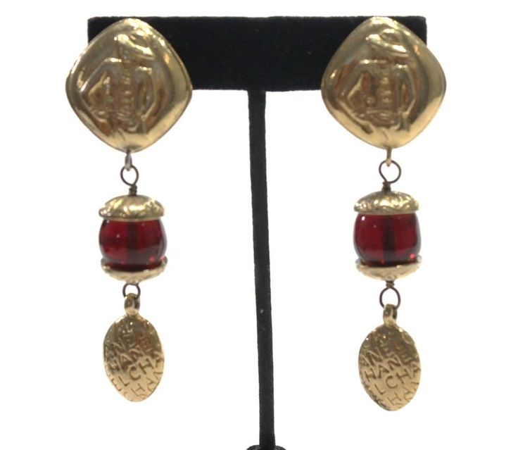 Beautiful Chanel earrings with Coco on the top and dangling red Gripoix cabochons. Marked: Chanel, France. Clip On. Includes box. | eBay!