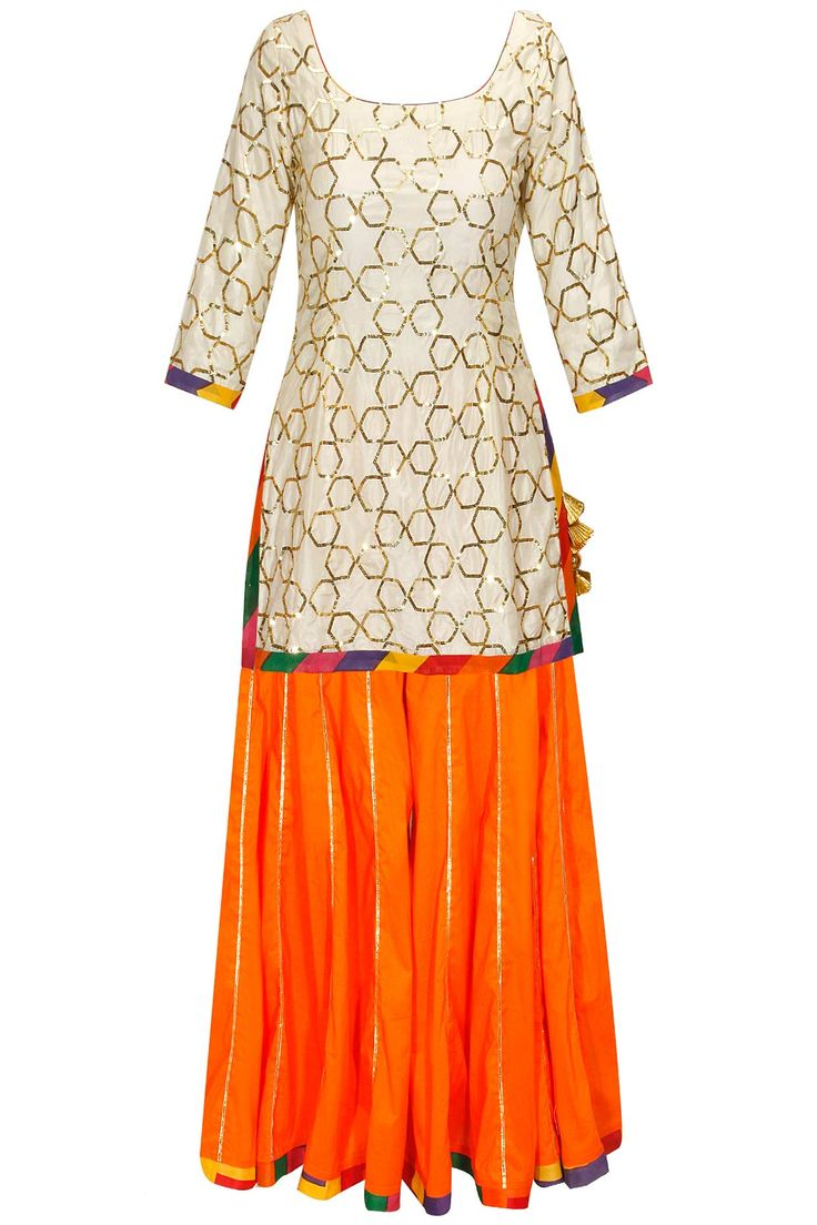 Cream gota embroidered kurta with orange sharara pants and dupatta by Ayinat.