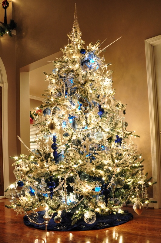 This is our flocked tree decorated with crystal glass