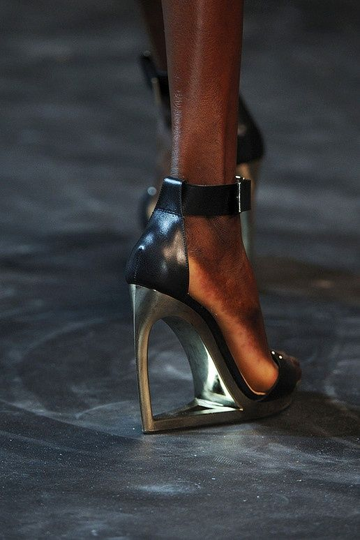 This image is from the Lanvin Fall 2011 Runway which featured models with  shoes reminiscent of