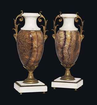 A PAIR OF GILT-BRONZE MOUNTED WHITE MARBLE AND DERBYSHIRE BLUE-JOHN VASES  THE BLUE-JOHN EARLY 19TH CENTURY, THE WHITE MARBLE AND MOUNTS LATE 19TH CENTURY  With scrolled handles, on stepped square bases  11½ in. (29.3 cm.) high (2)