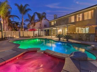 """For sale: $609,900. Truly immaculate pool home in South Corona.  One of the largest and deepest lots in the community.  Backyard is perfect for entertaining - pool and spa with """"party lights"""", fire pit, BBQ, patio cover, vinyl fencing, and plenty of palms with outdoor lighting.  BBQ island has built in BBQ, fridge, and plenty of seating.  Low maintenance backyard with stamped concrete throughout.  Plenty of curb appeal here with beautifully manicured front yard landscaping, stamped ..."""
