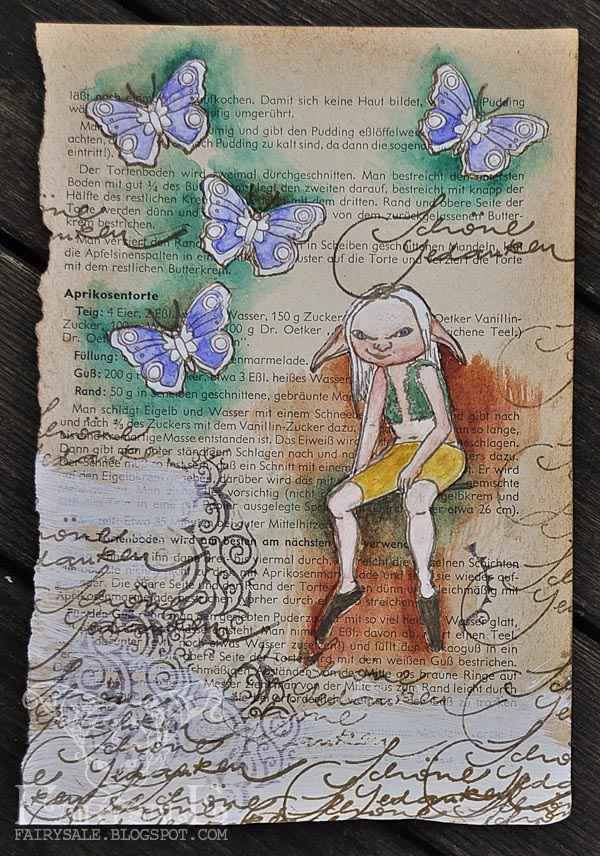 stamped and coloured on book page
