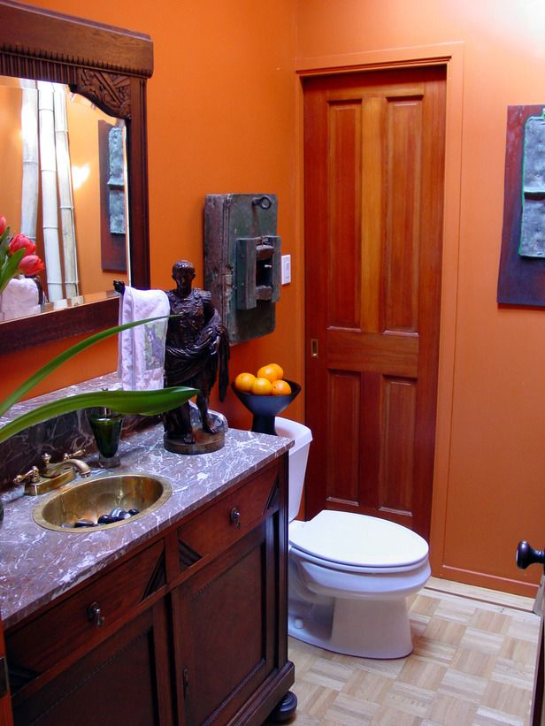 Warm Retreat  For a bold yet relaxing master bathroom, designer Jane Ellison combined Old World style and dark wood furnishings with a soothing deep orange wall color. The colors and textures of the space immediately emit a feeling of warmth and sophistication.