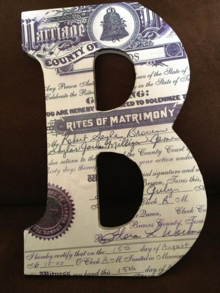 Modge podge a copy of your marriage certificate to the first letter of your last name!  Love it :) Very personal and special