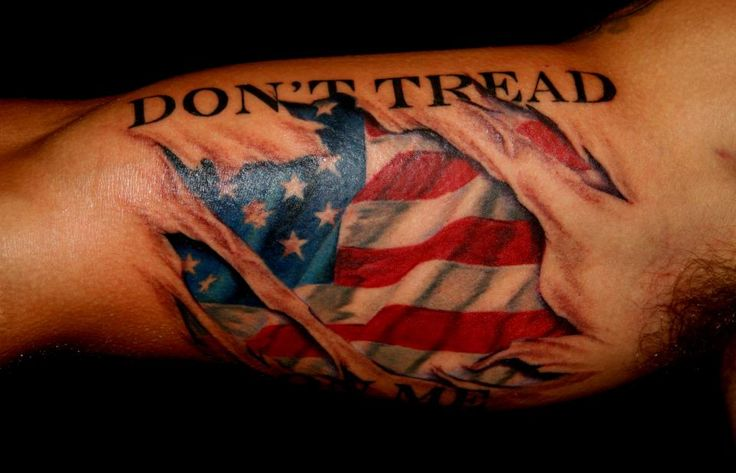 Another tattoo Jeff did yesterday. They had an idea to make the text 'Dont Tread on Me' seem like the tattoo had been ripped to reveal the American Flag under his skin.