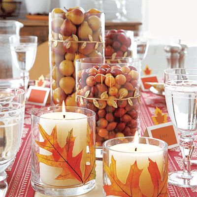 Thanksgiving centerpiece ideas: Decorate tall cylinder glass vases with season items for an instant centerpiece. We filled these with fall leaves, crab apples, small pears and cranberries, but you can use what you have on hand.