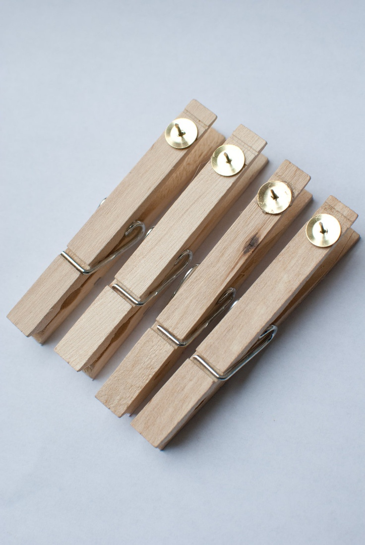 "Hot glue drawing pins onto pegs. Use them to hang work on a cork board in the classroom ("",)"