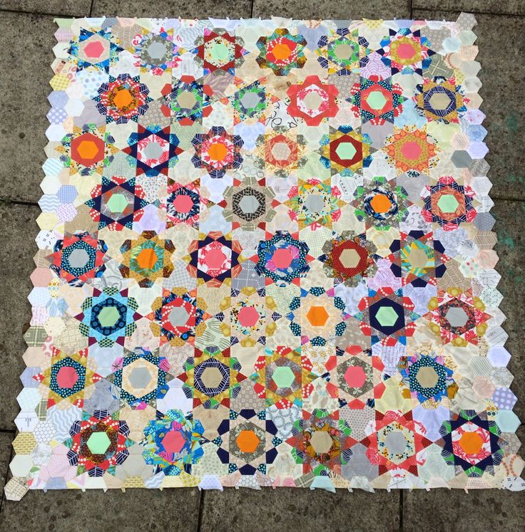 Charm About You: Rose Star from  http://www.charmaboutyou.com/2014/08/my-rose-star-quilt-top.html