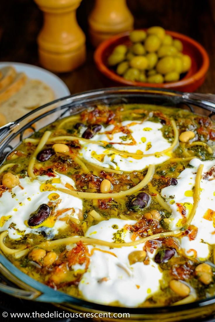 persian noodle soup with beans and herbs