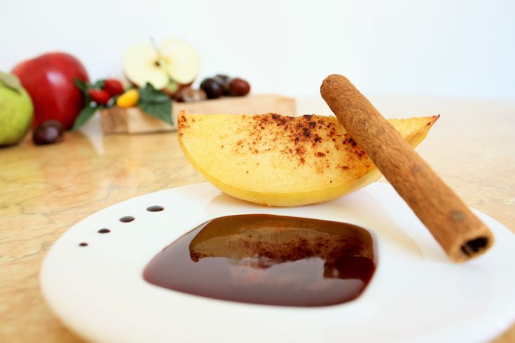 Autumn delicious and healthy recipe. Baked quinces with cinnamon and red wine syrup.
