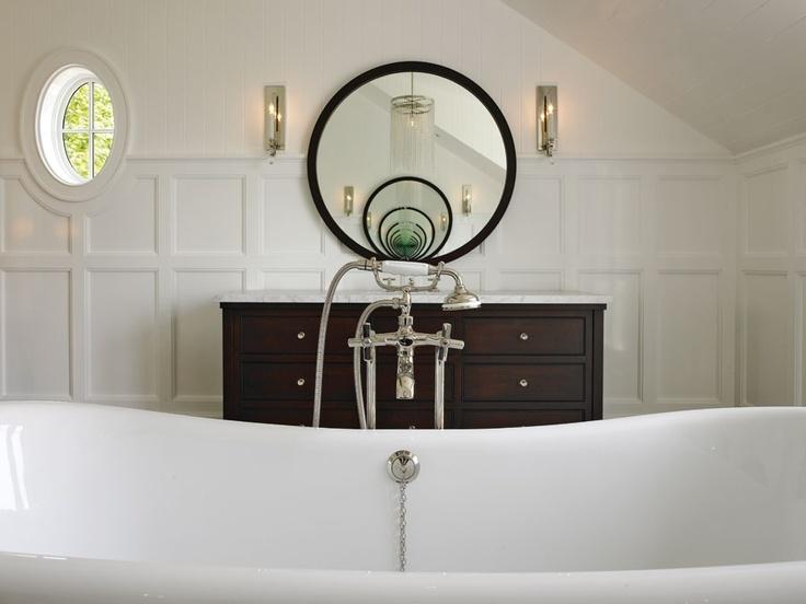 Round Mirror Next To Oval Window Mahogany And White