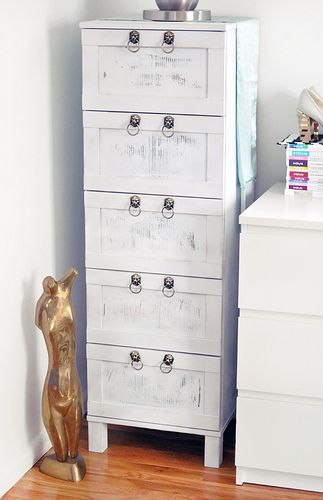 Cheap ikea drawers sanded, spray painted and distressed with sand paper add lion drawer pulls. Fabulous.