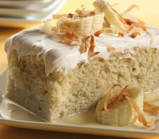 """Tres leches means """"three milks"""" in Spanish; it's a traditional Latin American dessert that features delicious, spongy cake soaked in evaporated milk, condensed milk and heavy cream. Make a fooproof version of this restaurant favorite at home using Betty's white cake mix, mashed bananas and coconut milk. Top with toasted nuts for a little crunch!"""