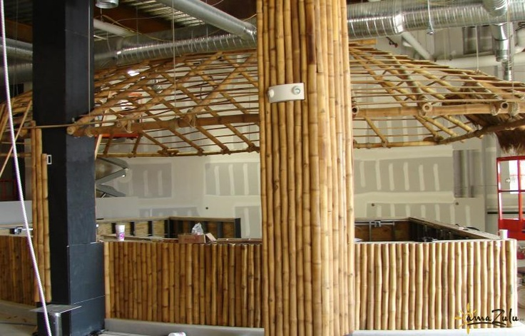 Bamboo poles are being used to create a decorative, thematic bar. Tre-Gai Bamboo Poles offer a natural, versatile alternative to more traditional building materials. They have a rustic, authentic look while being the only species of bamboo approved as a construction-grade material. It's light tan color will deepen after it has been sanded and finished. Learn more at http://www.amazuluinc.com/products/bamboo/tre-gai-bamboo