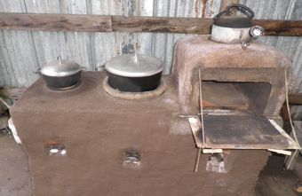 My outdoor oven...it's a rocket stove.   Step by step picture instructions.