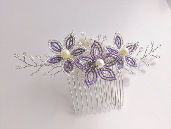 Purple flower hair comb with silver leaves>  This elegant and sparkly flower hair comb is carefully handcrafted with purple and silver seed beads,