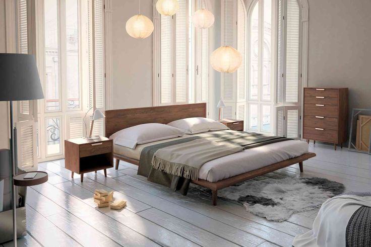 Asher is a mid-century modern inspired bed with tapered legs and beautiful dark-stained walnut veneer, available in Queen or King.