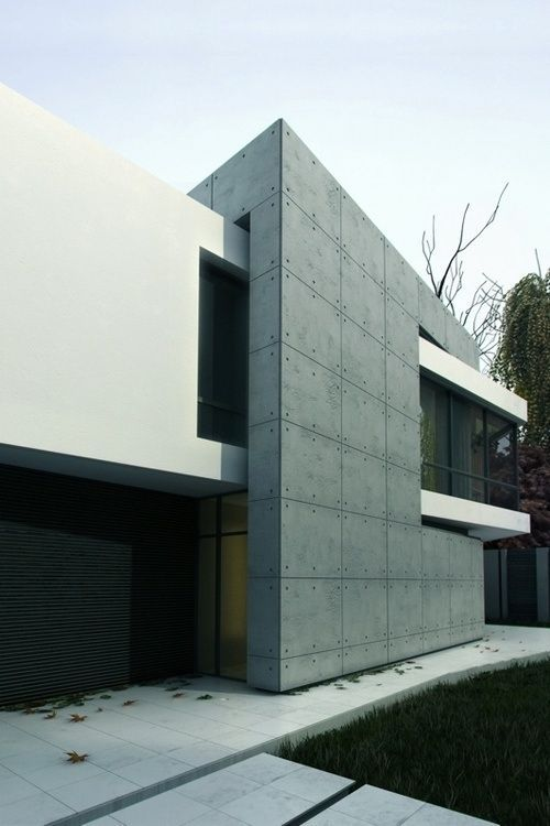 Additive form interlocking spaces ultra modern house for Modern house design materials
