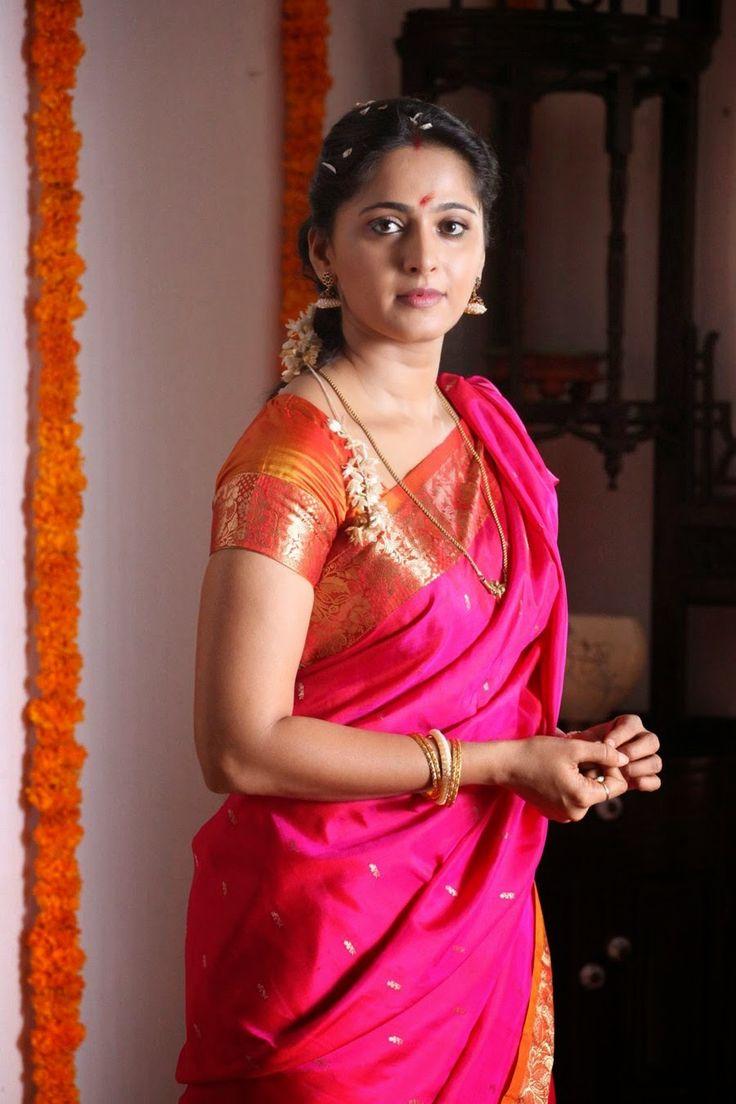 Anushka Shetty Cute Stills In Red Saree - Anushka Shetty