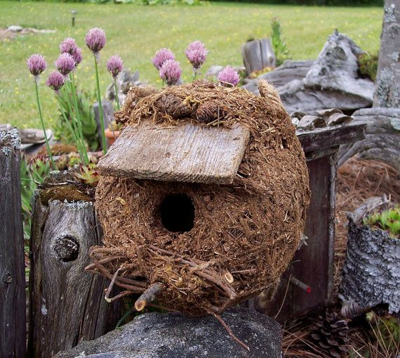 Birdhouse made with natural materials mixed with hypertufa mix.