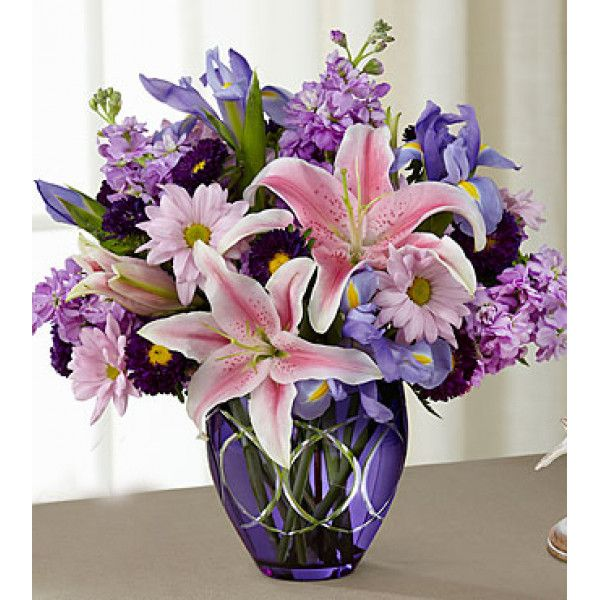 #Samedaydelivery : Radiant Bouquet makes an inspired use of harmonizing and contrasting hues. Soft pink Oriental #Lilies, ruffled columns of #lavender gilly #flowers, deep blue #irises, lavender #daisies, purple #matsumoto asters and lush greens create a simply stunning arrangement in a deep purple glass vase.