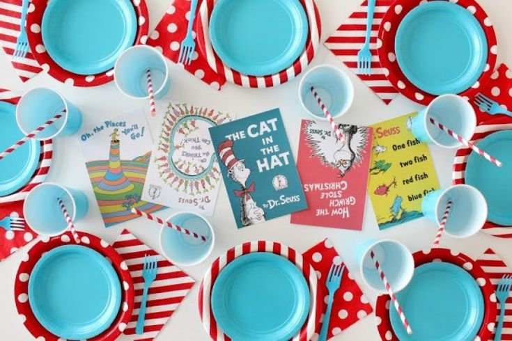 The BEST Dr. Seuss 1st Birthday Party Ideas including a Red Fish, Blue Fish Candy Bar, Dr. Seuss inspired cake, Cat in the Hat cookies and more!