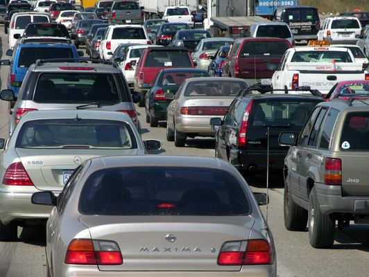 """License Plate Blockers...We've heard that In Tehran, there are new traffic restrictions in an attempt to reduce congestion & pollution from the number of cars.. They are enforcing odd-even traffic restrictions on alternative days. Traffic cameras are used to check the tag numbers. the """"license blockers"""" wait on the less crowded streets which connect to the restricted areas & get paid to walk behind the car so your tag number cannot be captured by the camera! If this is true, let us know!"""