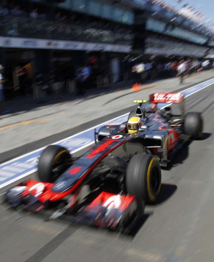 McLaren Formula One driver Hamilton drives in the pit lane during the third practice session of the Australian F1 Grand Prix at the Albert Park circuit in Melbourne