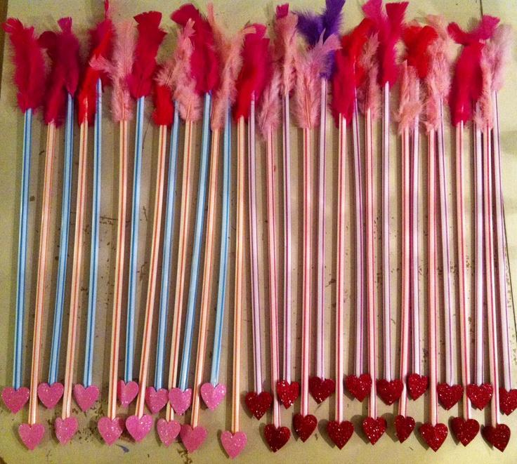 Arrow Valentines :: Giant pixie stix, feathers & glitter hearts.