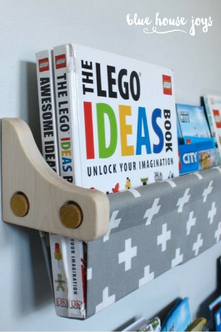 A stylish and inexpensive book sling to store your kids' books. Hang this up at any height and give your child a simple way to grab their favorites for a quick read. Choose from maple or white brackets. Perfect for playrooms, nurseries, and kids spaces. Visit our shop at bluehousejoys.com/shop/ for more inspiration!