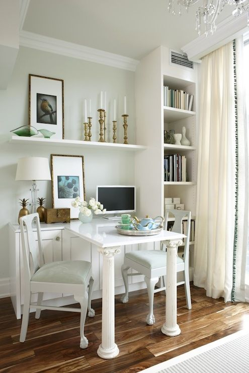 Great use of a small space...bookshelves, floating shelves, console and table multi-functions as dining or office space.