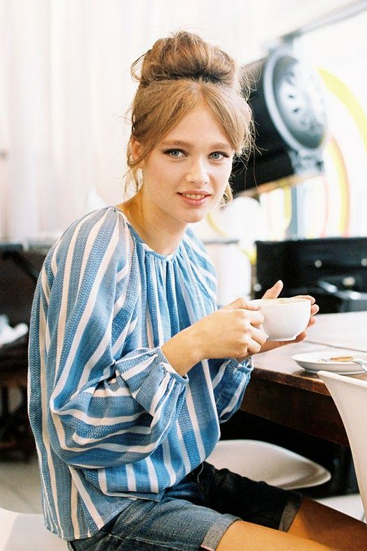 High bun + bangs. Love her natural make-up and effortless outfit as well.