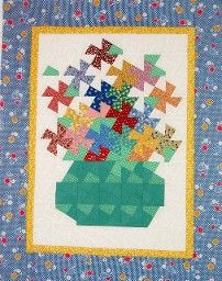 """I like the use of the """"leftovers"""" to create the vase.  Quilt Pattern Designs"""