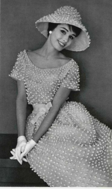 1959 Sondra Peterson in charming white organdy embroidered in tiny florets, waist is tied in white satin, wide-brimmed hat of same material, by Christian Dior (Yves Saint Laurent), photo by Pottier