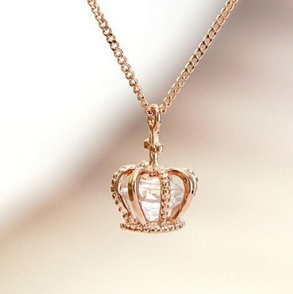 Crown pendant necklace with enclosed Swarovski diamond cut crystal. Available in yellow and rose gold. #crown #jewels $24.99