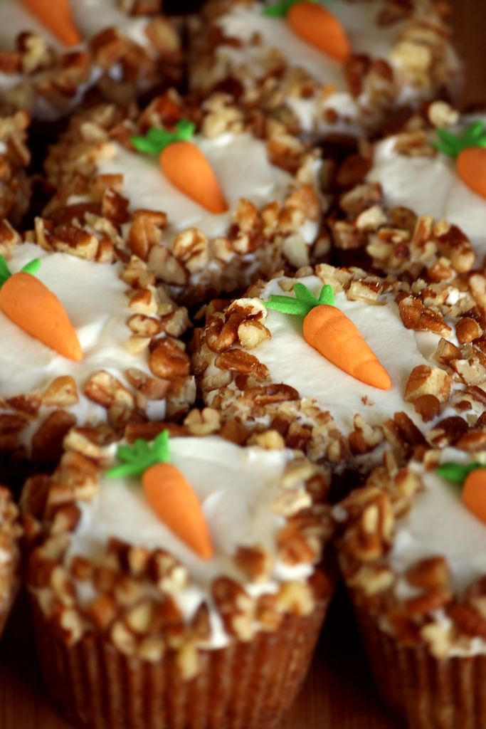 Carrot Cake Cupcakes with Cream Cheese Icing......love the decoration of pecans and simple carrot decoration made from gum paste...
