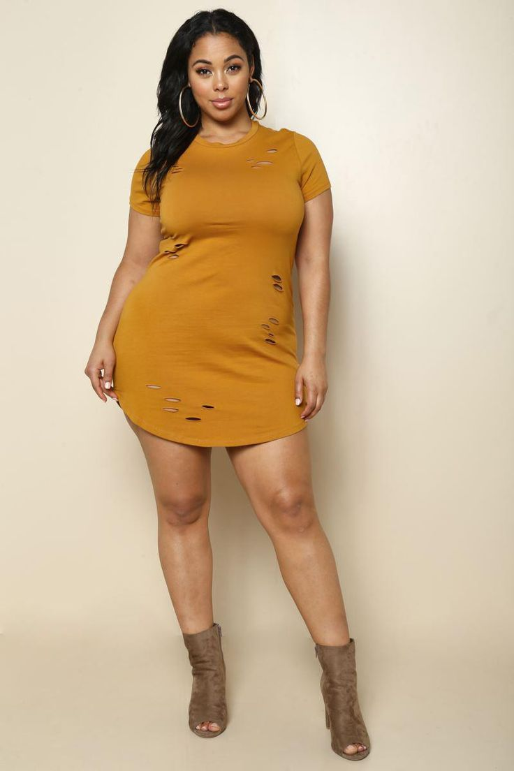 A plus size mini dress that is minimal yet undeniably stylish. Features a crew neck, short sleeves, and perfectly cut-out fabric that shows off some skin. Made with a rounded, finished hem and solid color.
