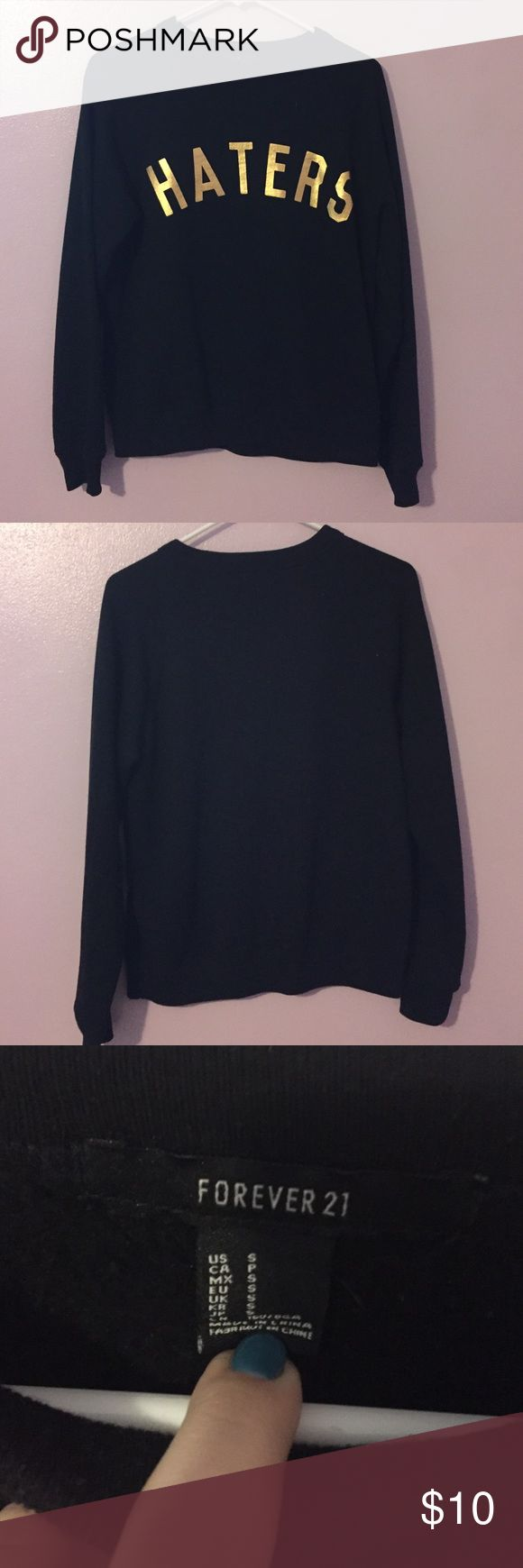 """Black haters sweatshirt Black sweatshirt with the word """"haters"""" in gold on it. Very comfy. Worn a few times. Perfect condition. Forever 21 Tops Sweatshirts & Hoodies"""