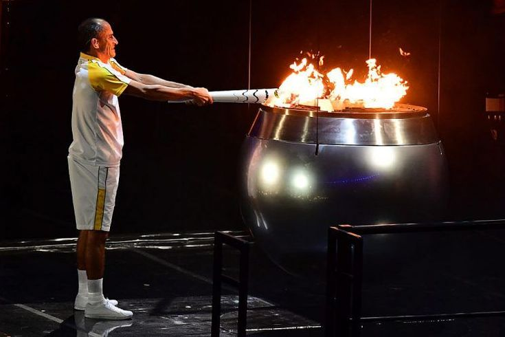Top 12 memorable moments of Rio Olympics Opening Ceremony - 12. Finally, It's Lit!! - Former Brazilian athlete Vanderlei Cordeiro lights the Olympic cauldron with the Olympic torch during the opening ceremony of the Rio 2016 Olympic Games at Maracana Stadium in Rio de Janeiro on August 5, 2016. / AFP / Emmanuel DUNAND (Photo credit should read EMMANUEL DUNAND/AFP/Getty Images)