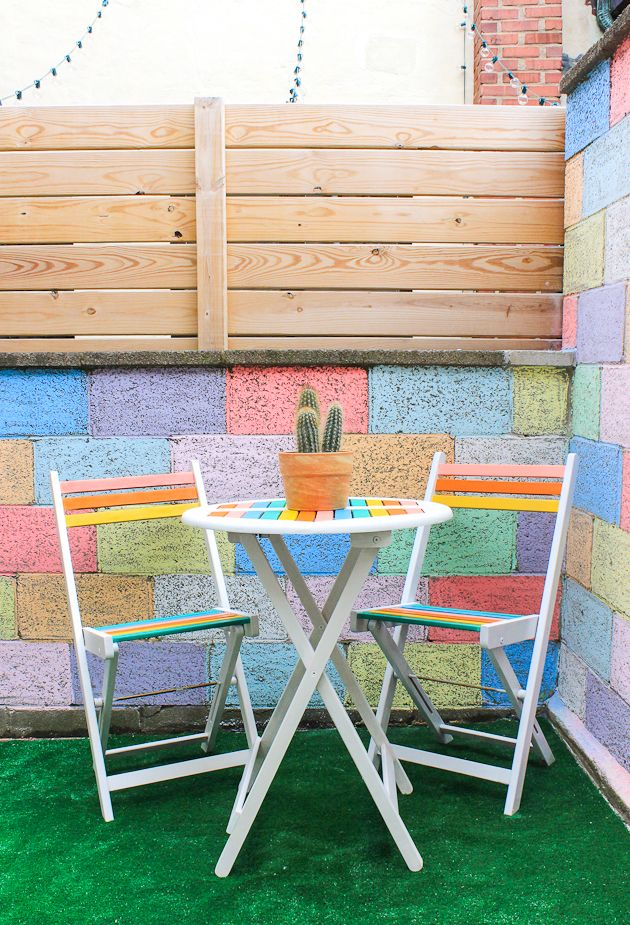With just a bit of paint you can make a cheap bistro set feel like you're in Palm Springs! Click through for full tutorial.