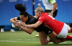 Portia Woodman goes over for the first try for New Zealand.