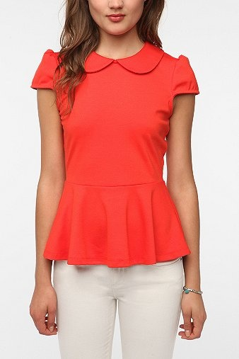 Two trends in one: Peter Pan collar, peplum waist.