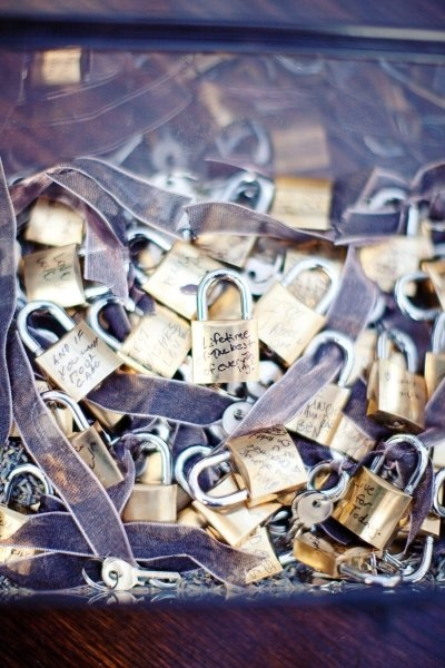 Wish locks guestbook. Guests write their  wishes for the couple on locks.