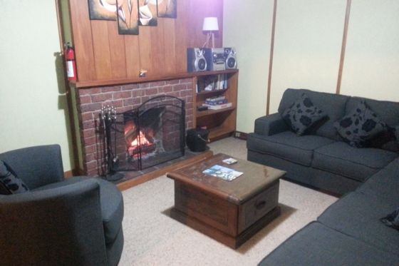 The lounge room with open fireplace