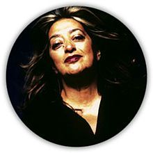 """Dame Zaha Mohammad Hadid is an Iraqi-British architect. She received the Pritzker Architecture Prize in 2004-the first woman to do so-and the Stirling Prize in 2010 and 2011. Her buildings are distinctively futuristic, characterized by the """"powerful, curving forms of her elongated structures with 'multiple perspective points and fragmented geometry to evoke the chaos of modern life""""."""